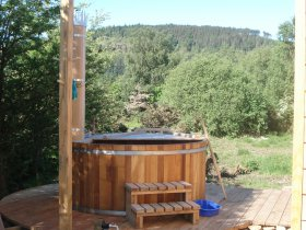 An image showing the hot tub and views from Loch Ken Eco Bothies self catering accommodation eco ret