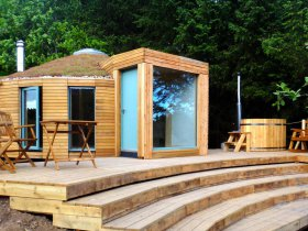 An image showing the exterior with hot tub of Loch Ken Eco Bothies self catering accommodation eco r