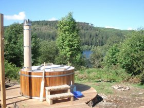 An image showing the luxury hot tubs of Loch Ken Eco Bothies self catering accommodation eco retreat