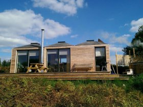 An image showing the exterior of red squirrel at Loch Ken Eco Bothies self catering accommodation ec