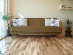 An image showing a stylish sofa at Loch Ken Eco Bothies self catering accommodation eco retreats in